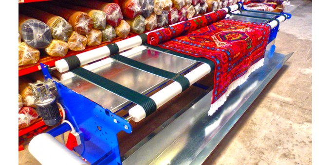 Carpet and rug rolling and packing machine